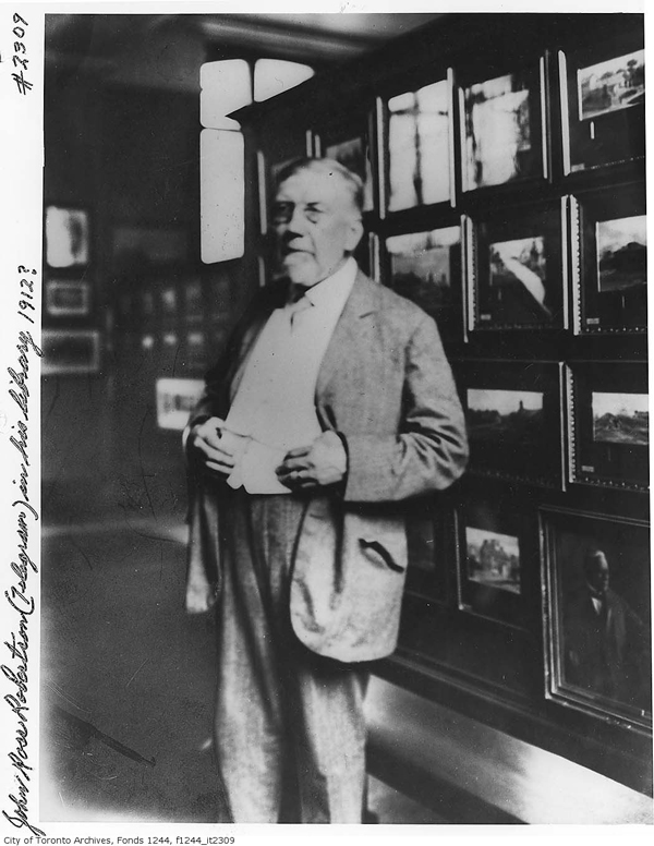 John Ross Robertson with his collection at the Toronto Reference Library,  about 1912.